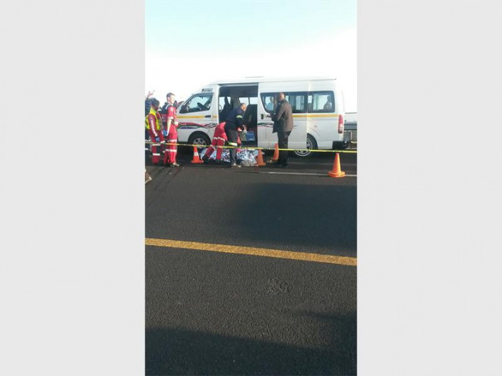 ER24 paramedics helping passengers at the crime scene on the N12 West.