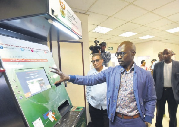 Minister of Home Affairs Malusi Gigaba inspects the automated booking system at Marabastad refugee reception office in Tshwane. Picture: Nigel Sibanda