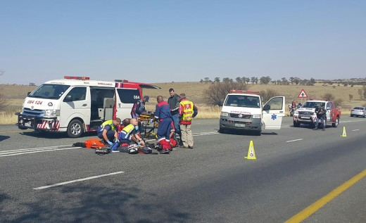 ER24 paramedics attend the the scene of one of three motorbike collisions near Parys this morning. Picture: Vaal Weekblad.
