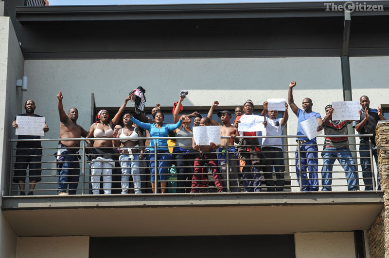 Employees of DIRO mine near the town of Kathu, protest on the balcony of their company offices at Tugela House, 9 September 2016, Centurion. Picture: Jacques Nelles