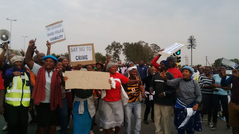 Residents marching this morning against crime after a Pakistan resident was killed in ext 4.