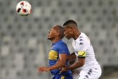 CAPE TOWN, SOUTH AFRICA - SEPTEMBER 17:  Lehlohonolo Majora of Cape Town City FC and Thulani Hlatshwayo of Wits during the MTN 8 Semi Final, 2nd Leg match between Cape Town City FC and Bidvest Wits at Cape Town Stadium on September 17, 2016 in Cape Town, South Africa. (Photo by Carl Fourie/Gallo Images)