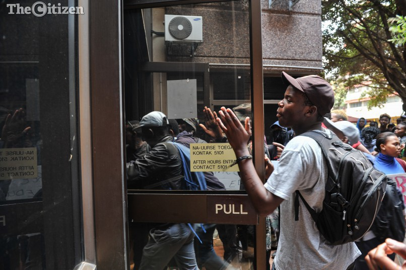 Tut students attempt to force entry into a building to disrupt classes at the TUT main Campus, 20 September 2016, Pretoria. Picture: Jacques Nelles