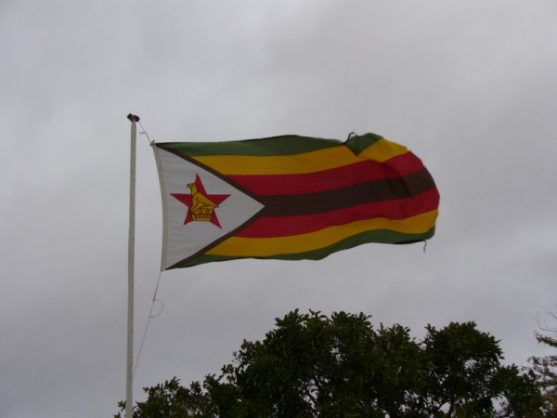 The Zimbabwean flag flying in the breeze.