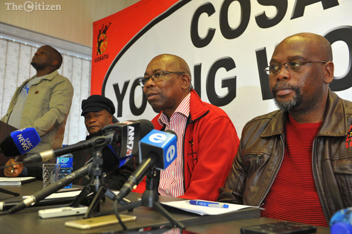 Cosatu General Secretary Bheki Ntshalintshali (centre) speaks at a press conference, 20 September 2016, at Cosatu House in Braamfontein, following the special CEC, while president Sdumo Dlamini looks on (right). The special CEC resolved to mobilise all workers to mark the international day of decent work on October 7. Picture: Michel Bega