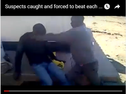 Screen-grab: Suspects beat each other