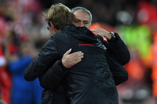 Liverpool's German manager Jurgen Klopp greets Manchester United's Portuguese manager Jose Mourinho (R) ahead of the English Premier League football match between Liverpool and Manchester United at Anfield in Liverpool, north west England on October 17, 2016. / AFP PHOTO / Paul ELLIS / RESTRICTED TO EDITORIAL USE. No use with unauthorized audio, video, data, fixture lists, club/league logos or 'live' services. Online in-match use limited to 75 images, no video emulation. No use in betting, games or single club/league/player publications.  /