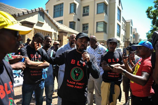 Andile Mngxitama addresses the other members of the Black First Land First movement outside the entrance to the public protector office premises after they marched from the University of Pretoria, 6 October 2016, Pretoria. Picture: Jacques Nelles