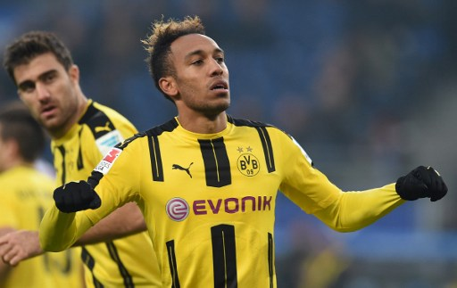 Pierre-Emerick Aubameyang from Dortmund celebrates his fourth goal to the 0:4 during the German first division Bundesliga football match between Hamburg SV and BVB Borussia Dortmund in Hamburg, northern Germany, on November 5, 2016.  / AFP PHOTO / CARMEN JASPERSEN / RESTRICTIONS: DURING MATCH TIME: DFL RULES TO LIMIT THE ONLINE USAGE TO 15 PICTURES PER MATCH AND FORBID IMAGE SEQUENCES TO SIMULATE VIDEO. == RESTRICTED TO EDITORIAL USE == FOR FURTHER QUERIES PLEASE CONTACT DFL DIRECTLY AT + 49 69 650050  / ALTERNATIVE CROP
