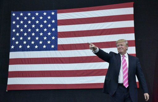 (FILES) This file photo taken on October 1, 2016 shows  Republican presidential nominee Donald Trump arrives for a rally at Spooky Nook Sports center in Manheim, Pennsylvania. Donald Trump said on November 9, 2016 he would bind the nation's deep wounds and be a president