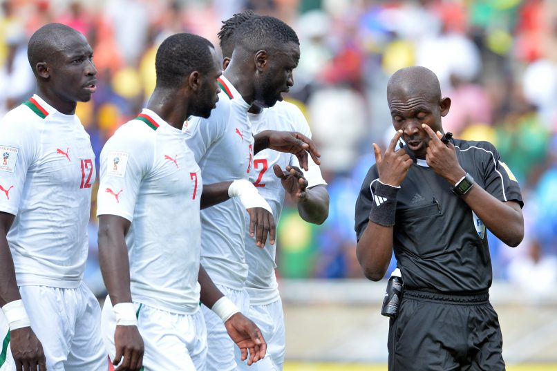 POLOKWANE, SOUTH AFRICA - NOVEMBER 12: Referee Joseph Lamptey  argue with Senegal players during the 2018 FIFA World Cup Qualifier match between South Africa and Senegal at Peter Mokaba Stadium on November 12, 2016 in Polokwane, South Africa. (Photo by Lefty Shivambu/Gallo Images)
