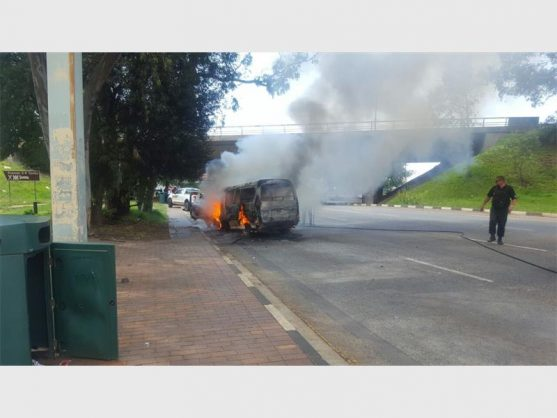 A taxi caught alight on Voortrekker Road just off the R21 on Monday. Photograph: ER24