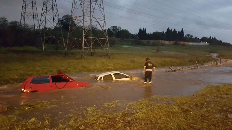More than 10 cars are submerged in water after flash flooding pushed them off the highway and down an embankment on Wednesday evening, November 9. Picture: Emer-G-Med.