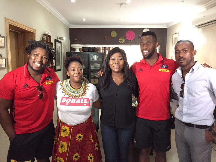 Scarra Ntubeni (L) and Siya Kolisi (R) have been lapping it up in Lagos. Photo: Twitter.