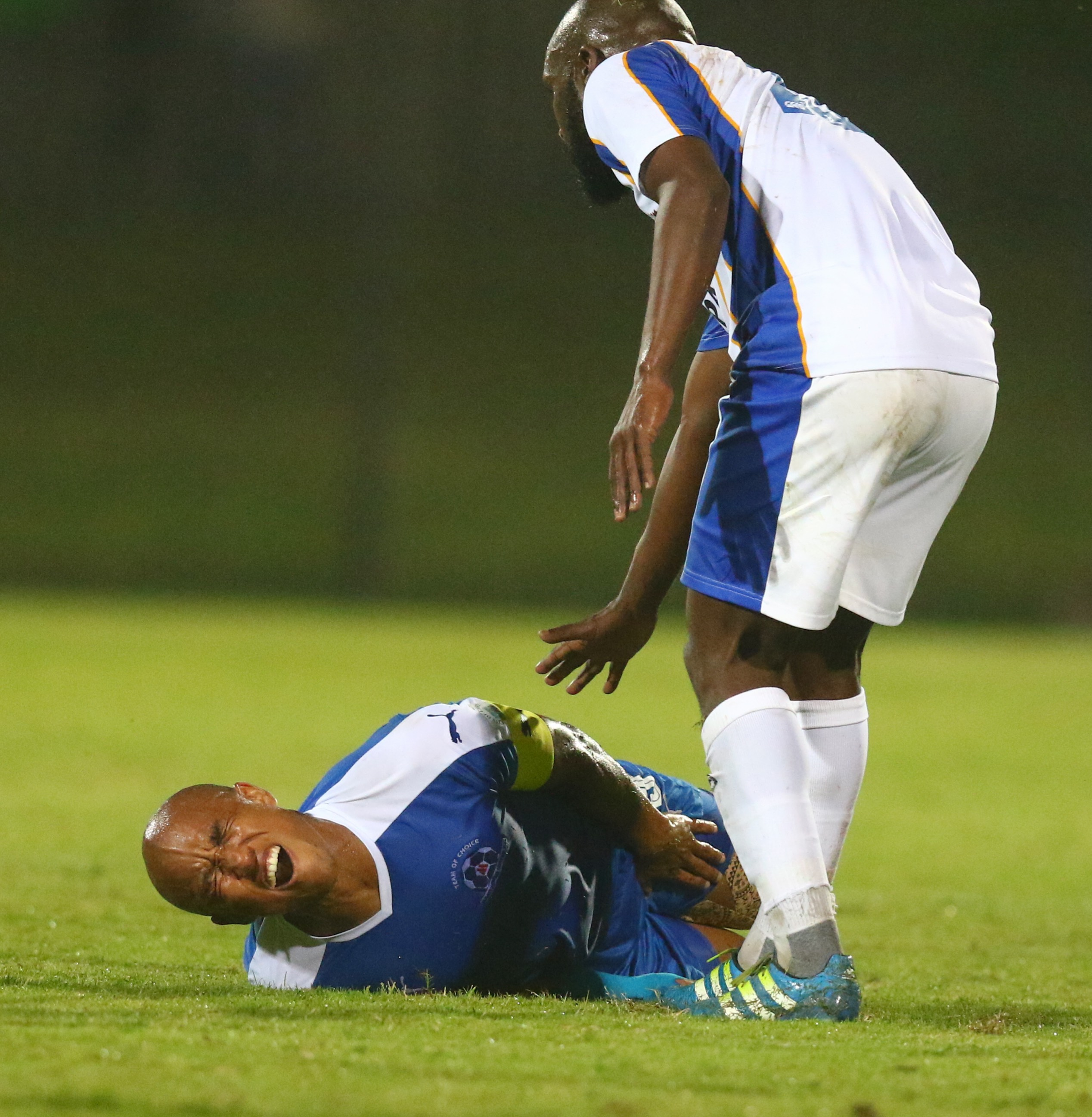 DURBAN, SOUTH AFRICA - NOVEMBER 29: Kurt Lentjies lies injured during the Absa Premiership match between Maritzburg United and Chippa United at Harry Gwala Stadium on November 29, 2016 in Durban, South Africa. (Photo by Anesh Debiky/Gallo Images)
