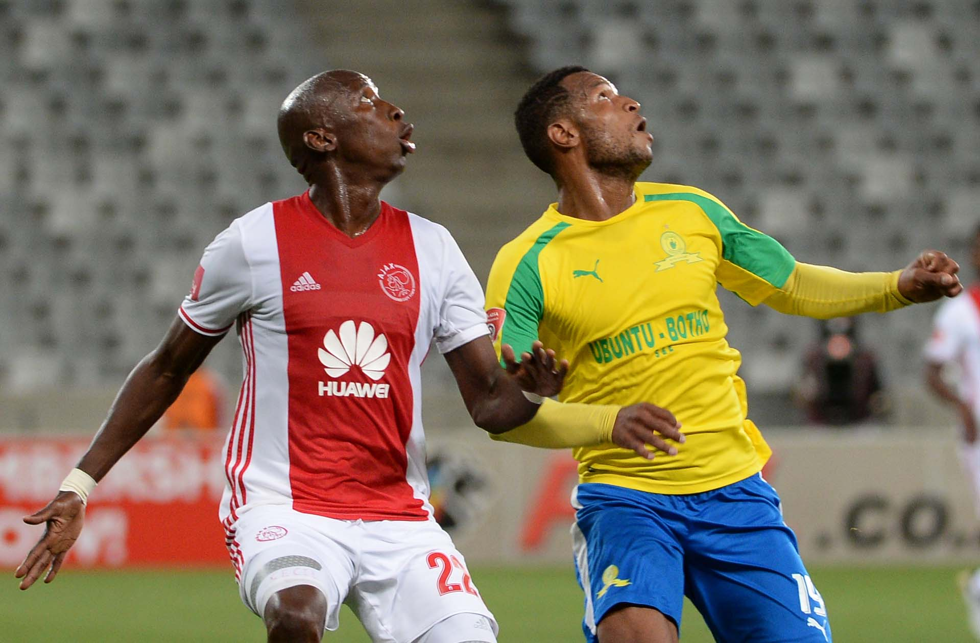 CAPE TOWN, SOUTH AFRICA - NOVEMBER 30: Mzikayise Mashaba of Mamelodi Sundowns and Luphiwana Mark Mayambela  of Ajax Cape Town during the the Absa Premiership match between Ajax Cape Town and Mamelodi Sundowns at Cape Town Stadium on November 30, 2016 in Cape Town, South Africa. (Photo by Thinus Maritz/Gallo Images)
