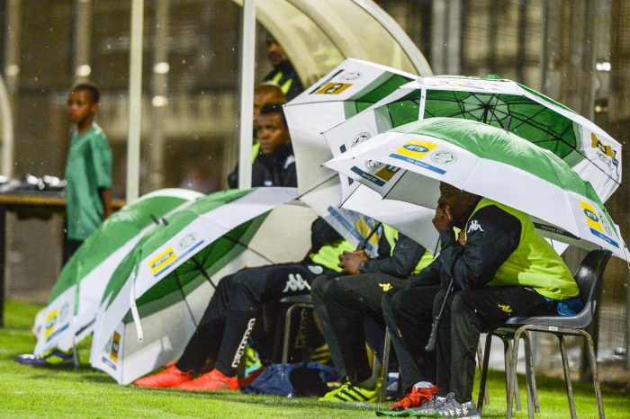 Bloemfontein Celtic bench block hide under umbrellas in the dugout during the Absa Premiership match between Highlands Park and Bloemfontein Celtic at Makhulong Stadium. (Photo by Sydney Seshibedi/Gallo Images)