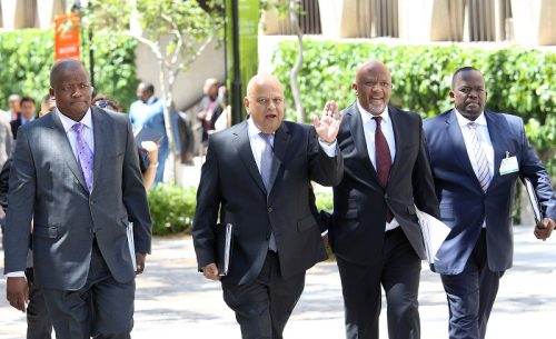 Minister of Finance Pravin Gordhan arrives with members of the National Treasury to present his 2016 Budget Vote Speech in the National Assembly on February 24, 2015 at Parliament in Cape Town, South Africa. Gordhan that he will be cutting government expenditure while still making R870-billion available for infrastructure development. (Photo by Gallo Images / The Times / Ruvan Boshoff)