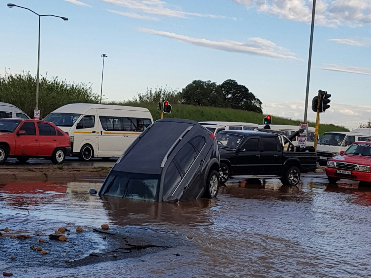 The car which took a nose dive into the hole on Zuurfontein Road. Picture: Brenda Short