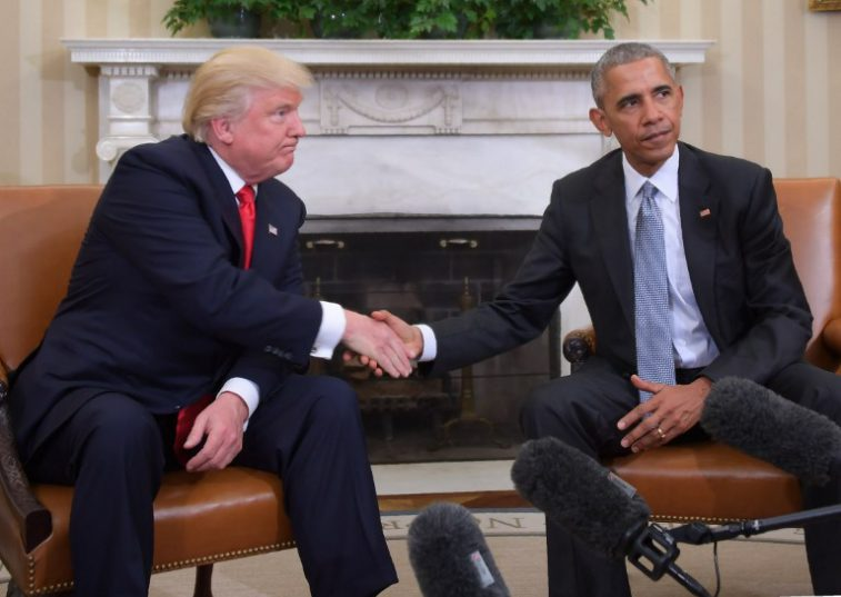 """(FILES) This file photo taken on November 10, 2016 shows US President Barack Obama and President-elect Donald Trump shake hands during a  transition planning meeting in the Oval Office at the White House on November 10, 2016 in Washington,DC.  US President-elect Donald Trump on December 28, 2016 accused Barack Obama of making """"inflammatory"""" statements and complicating the impending transfer of power -- the latest salvo in an escalating war of words with the current commander-in-chief. The unorthodox personal and public criticism of a sitting president comes less than a month before the 70-year-old Trump -- who defeated Obama's preferred successor Hillary Clinton in November's presidential election -- takes office.  / AFP PHOTO / JIM WATSON"""
