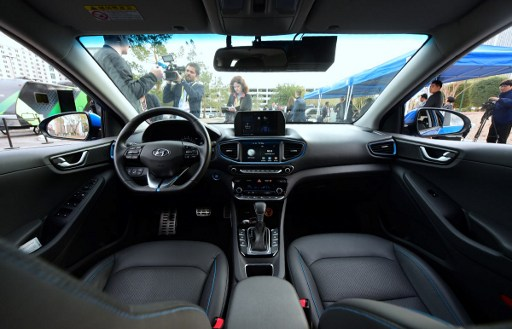 The front interior of Hyundai's Autonomous IONIQ vehicle is viewed at the 2017 Consumer Electronics Show in Las Vegas, Nevada, on January 4, 2017. / AFP PHOTO / Frederic J. BROWN