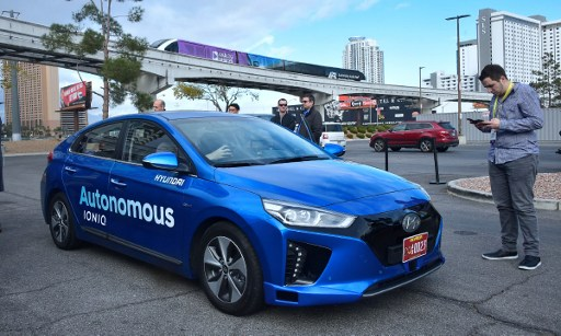 Hyundai's Autonomous IONIQ vehicle is taken for a test-ride at the 2017 Consumer Electronics Show in Las Vegas, Nevada, on January 4, 2017. / AFP PHOTO / Frederic J. BROWN