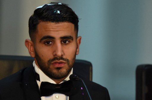 Algerian and Leicester striker Riyad Mahrez speaks after being crowned African Footballer of the Year in Abuja, on January 5, 2017.  Mahrez has been crowned the Confederation of African Football (CAF) African best Footballer for 2016, beating former best player and Gabonese forward Pierre-Emerick  Aubameyang  and Senegalese striker Sadio Mane, for the continent's most prestigious individual award.  / AFP PHOTO / PIUS UTOMI EKPEI