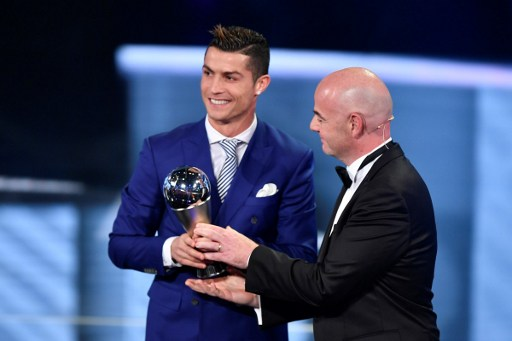Real Madrid and Portugal's forward Cristiano Ronaldo (L) is presented with The Best FIFA Men's Player of 2016 Award by FIFA president Gianni Infantino during The Best FIFA Football Awards ceremony, on January 9, 2017 in Zurich. / AFP PHOTO / Fabrice COFFRINI