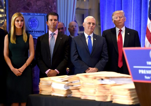 US President-elect Donald Trump(R) stands with his children Ivanka, Donald Jr. and Vice Preisdent-elect Mike Pence(2nd-R)during a press conference January 11, 2017 at Trump Tower in New York. Trump held his first news conference in nearly six months Wednesday, amid explosive allegations over his ties to Russia, a little more than a week before his inauguration. / AFP PHOTO / TIMOTHY A. CLARY