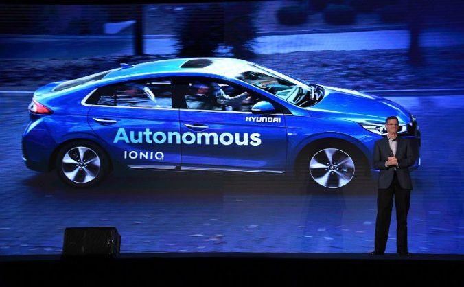 LAS VEGAS, NV - JANUARY 04: Hyundai Motor Co. Vice President Mike O'Brien speaks in front of a video image of the Hyundai autonomous Ioniq vehicle during a press event for CES 2017 at the Mandalay Bay Convention Center on January 4, 2017 in Las Vegas, Nevada. CES, the world's largest annual consumer technology trade show, runs from January 5-8 and is expected to feature 3,800 exhibitors showing off their latest products and services to more than 165,000 attendees.   Ethan Miller/Getty Images/AFP