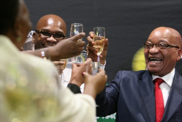 President jacob zuma shares a toast with then police