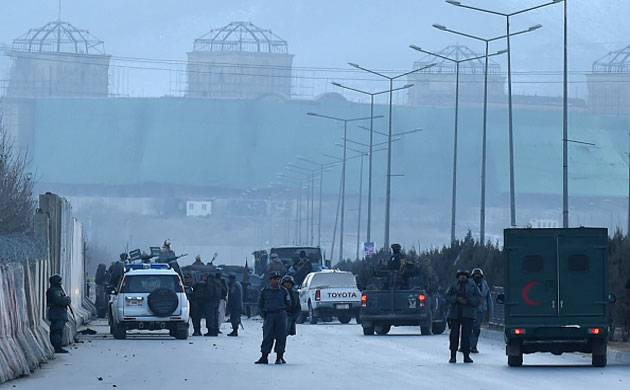 Afghan security personnel stand guard at the site of twin blasts near the Afghan parliament in Kabul. (Getty Images)