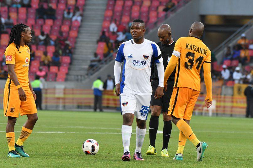 Lerato Manzini of Chippa United walks away with  Siphiwe Tshabalala and  Willard Katsande of Kaizer Chiefs in the background. (Iky Plakonoris/BackpagePix)