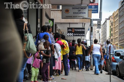 Parents and guardians are seen queing outside the department of education in Pretoria CBD, 9 January 2017, some people had been queing since 6am in the morning, Pretoria. Picture: Jacques Nelles