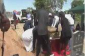 WATCH: Pall bearers slip into open grave