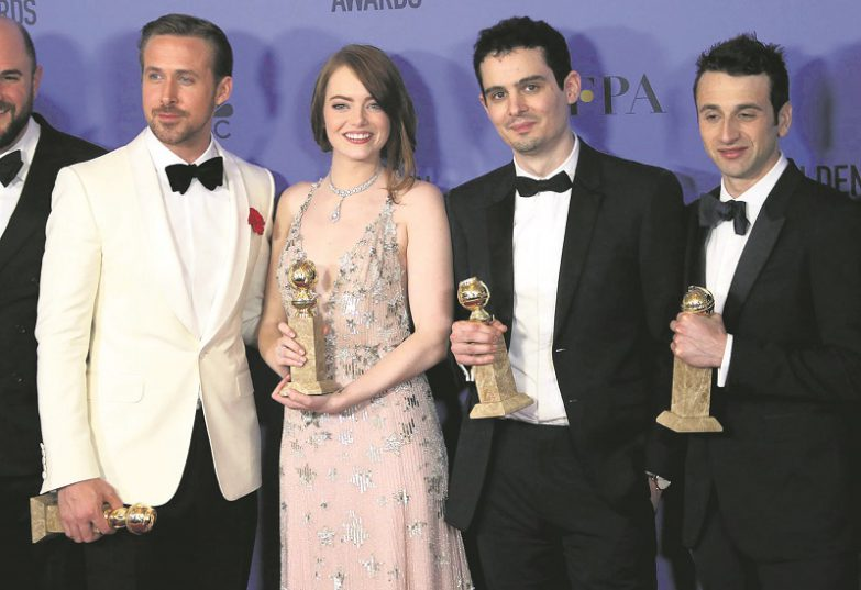epa05706431 (L-R) Ryan Goslin, Emma Stone, Damien Chazelle and Justin Hurwitz hold their awards for Best Performance by an Actor in a Motion Picture - Musical or Comedy, Best Performance by an Actress in a Motion Picture - Musical or Comedy, Best Director - Motion Picture and Best Original Score - Motion Picture, all for 'La La Land', in the press room during the 74th annual Golden Globe Awards ceremony at the Beverly Hilton Hotel in Beverly Hills, California, USA, 08 January 2017.  EPA/MIKE NELSON