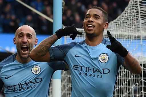 Manchester City's Brazilian striker Gabriel Jesus (R) celebrates with Manchester City's Argentinian defender Pablo Zabaleta after scoring their late winning goal during the English Premier League football match between Manchester City and Swansea City at the Etihad Stadium in Manchester, north west England, on February 5, 2017. Manchester City won the game 2-1. / AFP PHOTO / PAUL ELLIS / RESTRICTED TO EDITORIAL USE. No use with unauthorized audio, video, data, fixture lists, club/league logos or 'live' services. Online in-match use limited to 75 images, no video emulation. No use in betting, games or single club/league/player publications.  /