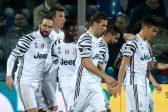 Juve extend Serie A lead, 9-man Milan win