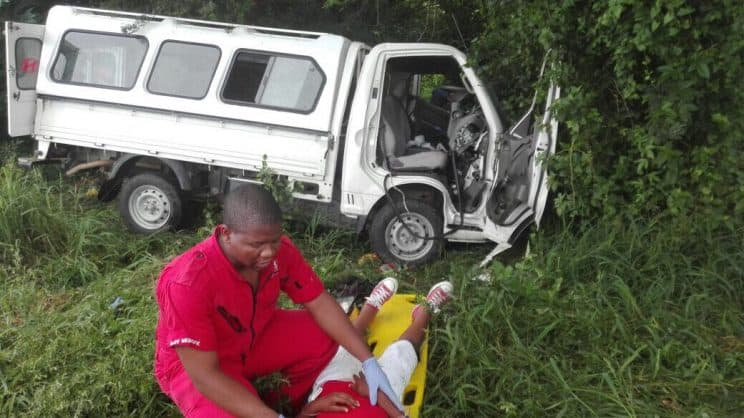 An IPSS Medical Rescue paramedic treats one of the children injured in this morning's crash. Photo: IPSS Medical Rescue.