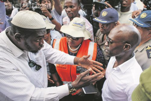 Minister of Home Affairs Malusi Gigaba talks to foreign nationals, 13 February 2017, in Yoeville Johannesburg in an attempt to engage with residents and foreign nationals following the recent violent protests in Rosettenville. Picture: Alaister Russell
