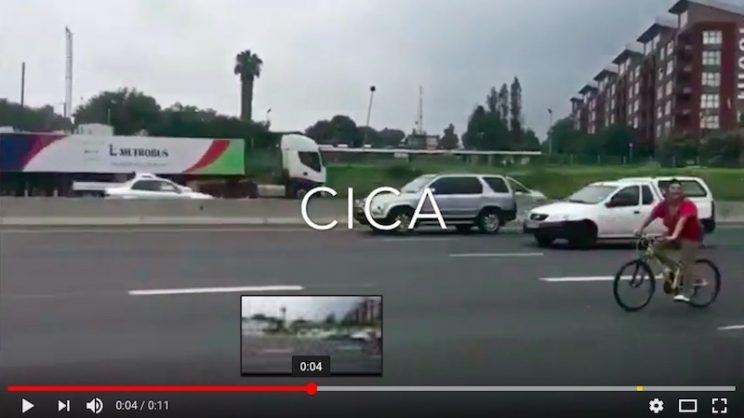 A screenshot of the video of the woman cycling without a helmet on a busy Joburg highway. Picture: CICA on YouTube
