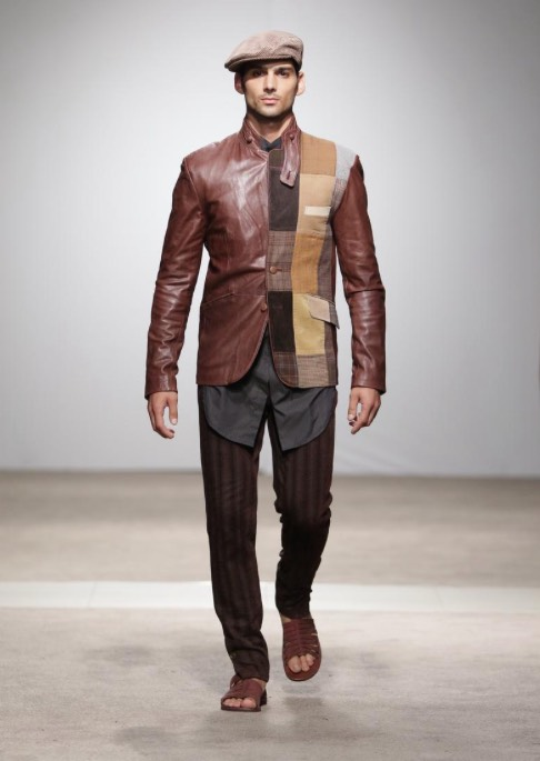 """A model showcases an interesting patchwork jacket from designer's Sheldon Kopman's Naked Ape label. This jacket is part of the label's """"Borrow Borrow"""" collection, showcased at the Lexus South African Menswear Week A/W 2017. Picture: SDR / Simon Denier."""