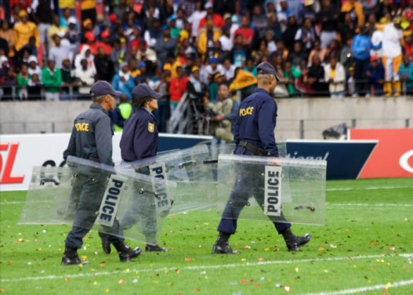 Police on the pitch during the Absa Premiership match between Chippa United and Kaizer Chiefs at Nelson Mandela Bay Stadium on May 09, 2015 in Port Elizabeth, South Africa. (Photo by Richard Huggard/Gallo Images)