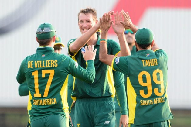 Chris Morris celebrates with his teammates. The lanky seamer bowled an excellent spell. Photo: Lee Warren/Gallo Images.