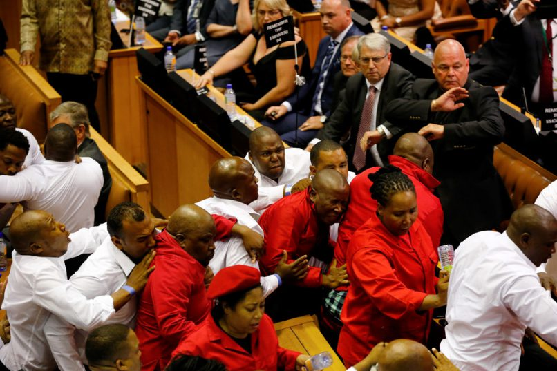 Julius Malema and his fellow opposition EFF MPs being bundled out of parliament for disrupting President Jacob Zuma's speech. Picture: Sumaya Hisham/Reuters