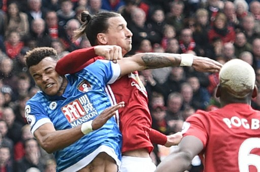 Manchester United's Swedish striker Zlatan Ibrahimovic (2L) clashes in the air with Bournemouth's English defender Tyrone Mings (L) during the English Premier League football match between Manchester United and Bournemouth at Old Trafford in Manchester, north west England, on March 4, 2017. / AFP PHOTO / Oli SCARFF / RESTRICTED TO EDITORIAL USE. No use with unauthorized audio, video, data, fixture lists, club/league logos or 'live' services. Online in-match use limited to 75 images, no video emulation. No use in betting, games or single club/league/player publications.  /