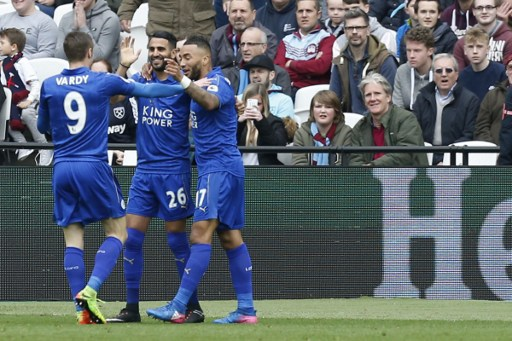 Leicester City's Algerian midfielder Riyad Mahrez (C) celebrates with Leicester City's English striker Jamie Vardy (L) and Leicester City's English defender Danny Simpson after scoring during the English Premier League football match between West Ham United and Leicester City at The London Stadium, in east London on March 18, 2017. / AFP PHOTO / Ian KINGTON / RESTRICTED TO EDITORIAL USE. No use with unauthorized audio, video, data, fixture lists, club/league logos or 'live' services. Online in-match use limited to 75 images, no video emulation. No use in betting, games or single club/league/player publications.  /