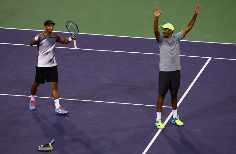 INDIAN WELLS, CA - MARCH 18: Raven Klaasen of South Africa and Rajeev Ram of the United States celebrate match point against Lukasz Kubot of Poland and Marcelo Melo of Brazil in the men's doubles final during day thirteen of the BNP Paribas Open at Indian Wells Tennis Garden on March 18, 2017 in Indian Wells, California.   Clive Brunskill/Getty Images/AFP