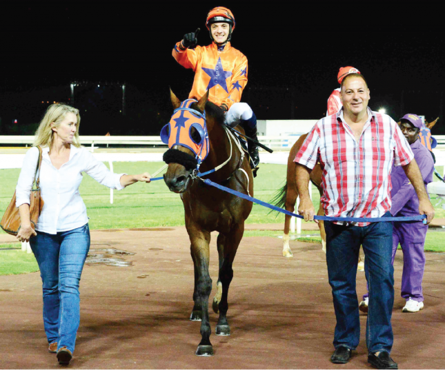 SWANSONG. Night Editor (Calvin Habib) is led into the winner's enclosure by Clinton Binda and his wife, Sue, at Turffontein after the son of Right Approach won his final race before being put out to pasture on 14 February.