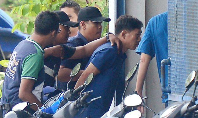 A North Korean man (R) identified by the Malaysian police as Ri Jong Chol.